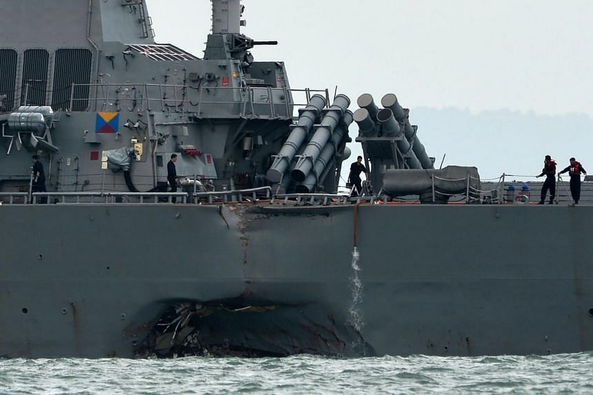 The guided-missile destroyer USS John S. McCain is seen with a hole on its portside after a collision with an oil tanker outside Changi naval base in Singapore on Aug 21, 2017.