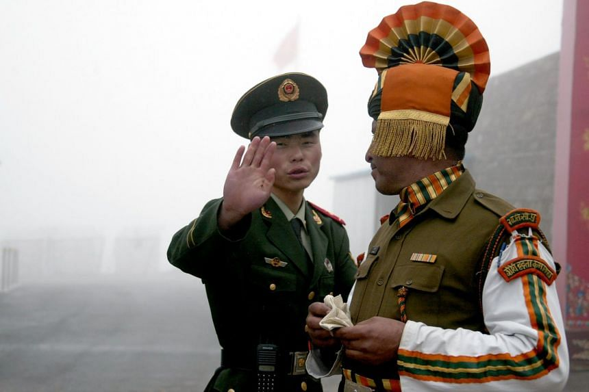 A Chinese soldier (left) next to an Indian soldier at the Nathu La border crossing between India and China in India's northeastern Sikkim state.
