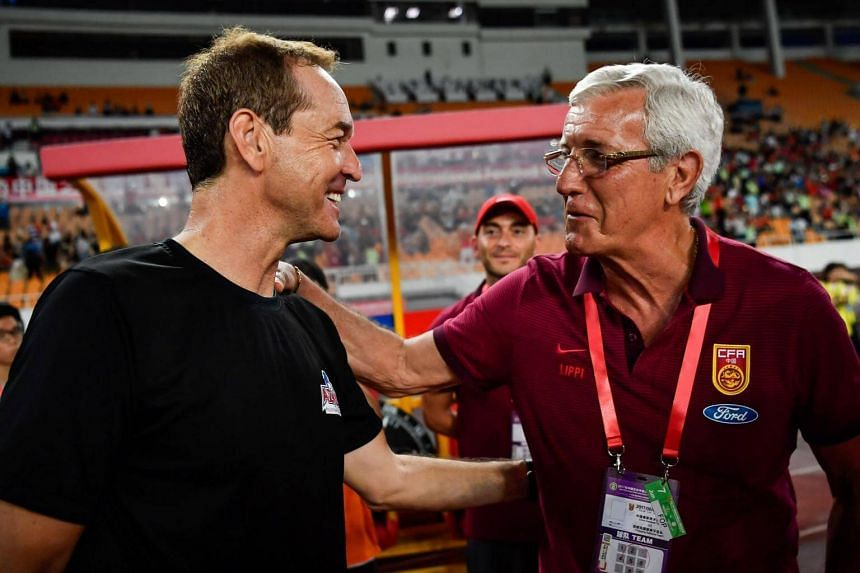China's coach Marcello Lippi (right) chats with Philippines coach Thomas Dooley after their football friendly in Guangzhou, in China's southern Guangdong province on June 7, 2017.