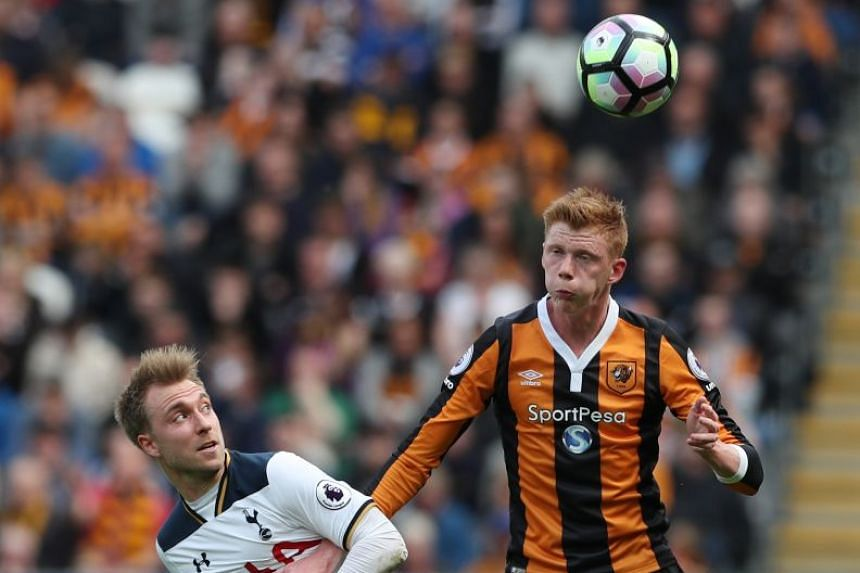 Tottenham's Christian Eriksen in action with Hull City's Sam Clucas.
