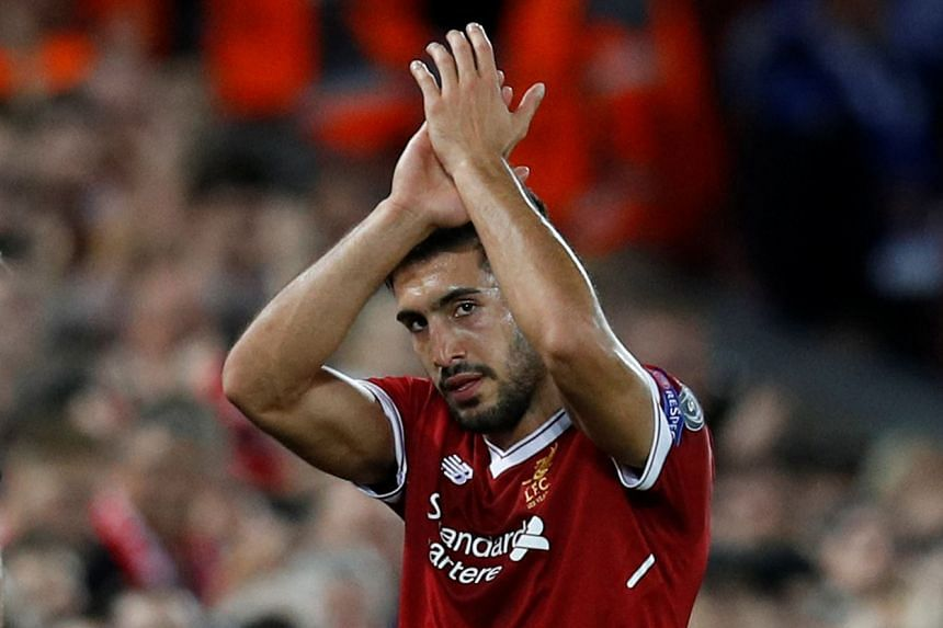 Double goal scorer Emre Can applauds fans as he is substituted off.