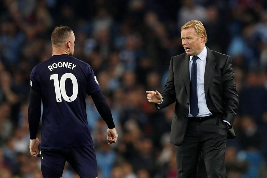 Everton manager Ronald Koeman (right) speaks with Wayne Rooney before the second half of the Premier League in Manchester, Britain, on Aug 21, 2017.