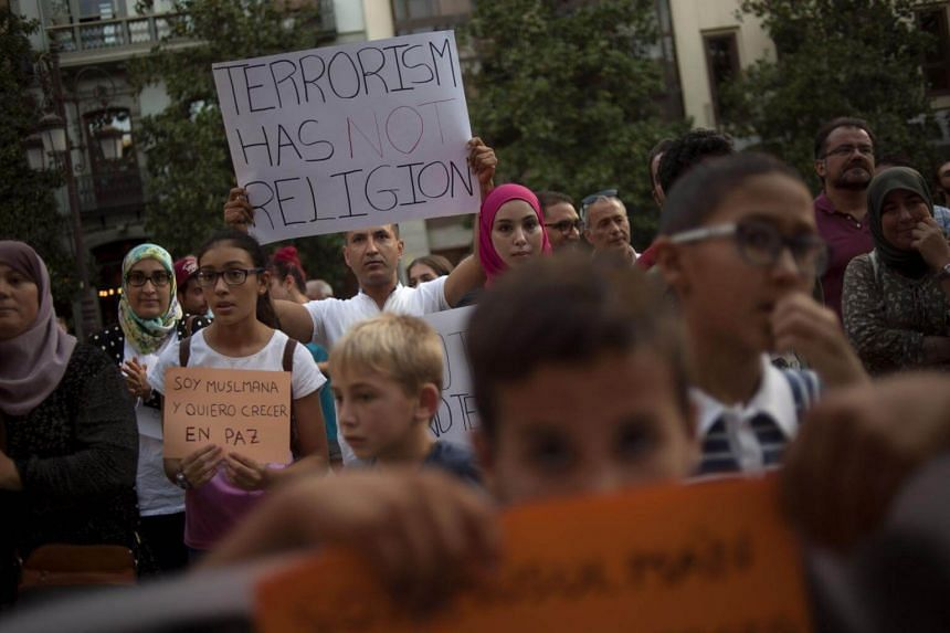 Muslims attend a demonstration in Granada on Aug 23, 2017 in protest against a surge in anti-Islamic hate crimes following last week's deadly attacks in Barcelona and Cambrils.