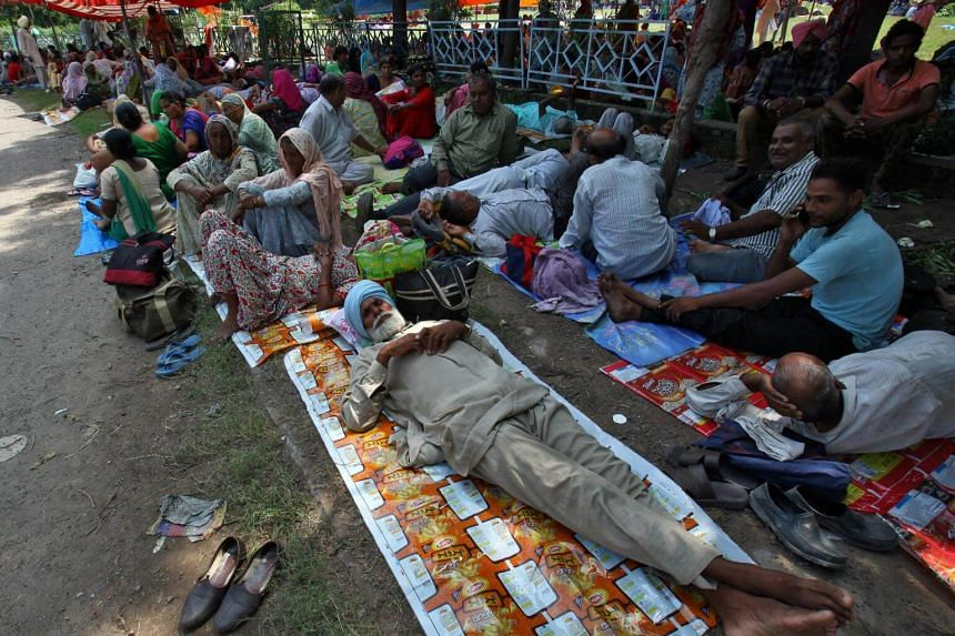 Supporters of Gurmeet Ram Rahim Singh rest as they gather near a stadium in Panchkula in the northern state of Haryana, India, on  Aug 24, 2017.