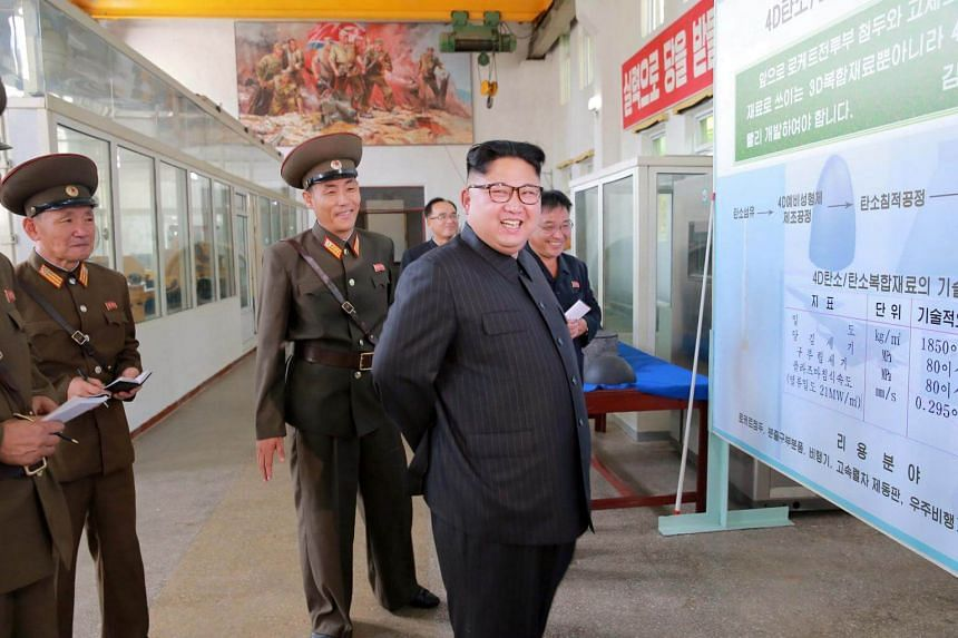 North Korean leader Kim Jong Un smiles during a visit to the Chemical Material Institute of the Academy of Defense Science in Pyongyang, on Aug 23, 2017.
