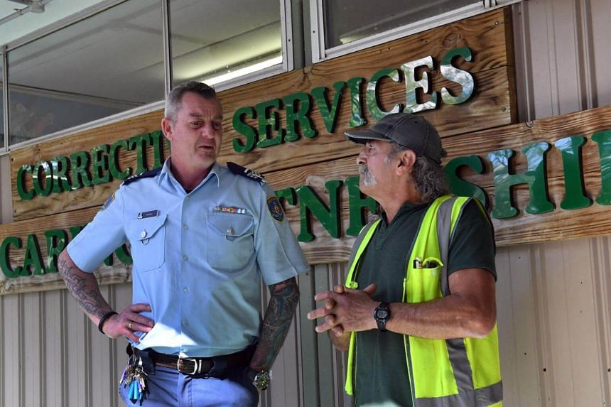 Officer in charge Ian Mitchell (left) talks to an inmate at John Morony Correctional Complex Wildlife Centre in Sydney, on Aug 24, 2107.