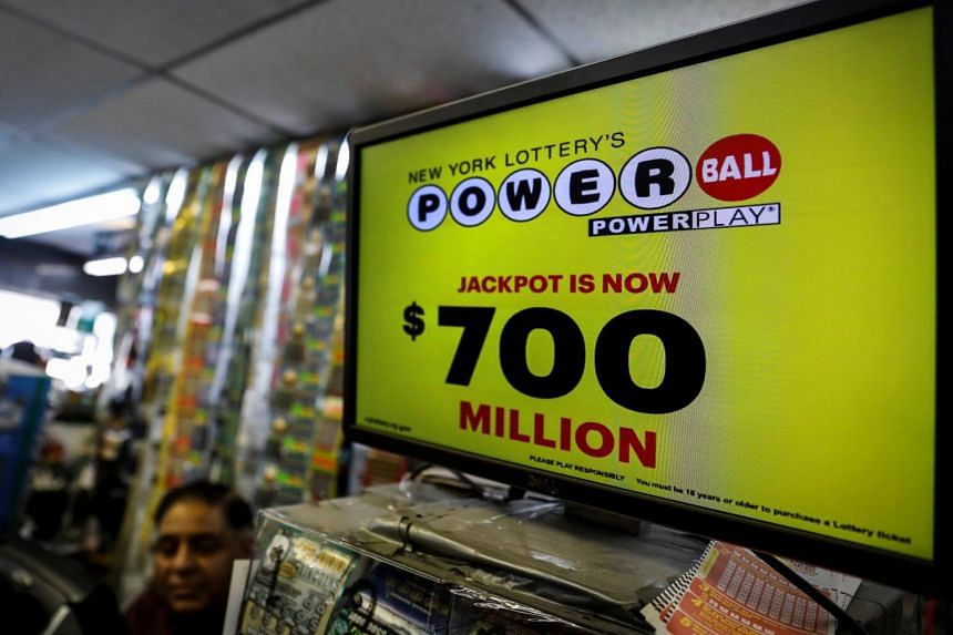A screen displays the value of the Powerball jackpot at a store in New York City, US, on Aug 22, 2017.