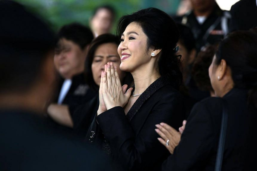 Former Thai PM Yingluck Shinawatra greeting supporters outside the Supreme Court in Bangkok on Aug 1, 2017.