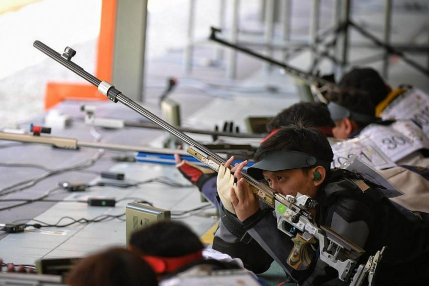 Shooter Ong Jun Hong preparing himself during the 50m rifle prone event on Aug 24, 2017.