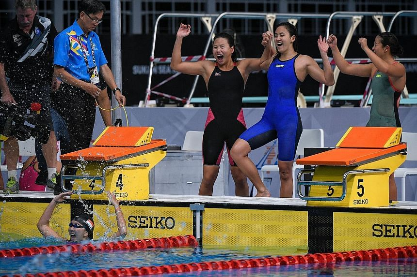 From top: Christie Chue (in black), Quah Ting Wen (in blue) and Rachel Tseng celebrate winning the 4x200m relay after a joyous Quah Jing Wen touched the wall ahead of the Thai and Philippine swimmers. Ting Wen overwhelmed with emotion after winning t