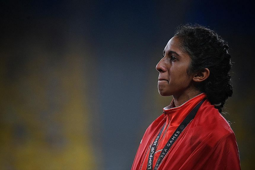 Shanti Pereira holding back tears on the podium after finishing third in the women's 200m final last night.