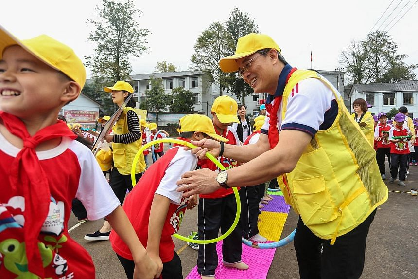 Mr Tan Seng Chai, group chief corporate officer of CapitaLand and executive director of CapitaLand Hope Foundation, joining the pupils of CapitaLand Jinzhu Hope School in Zhejiang in a sporting activity.