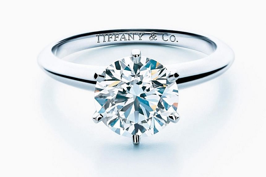 Tiffany invented a type of ring setting which shows more of the gem by setting the stone in a metal claw extending from the ring's band.