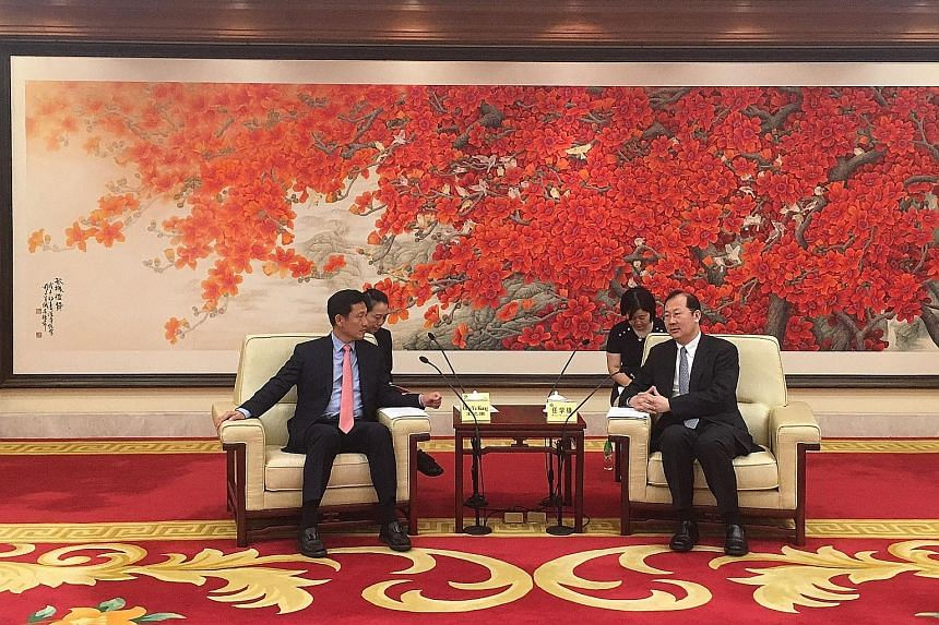 Mr Ong Ye Kung (far left) meeting Guangzhou party chief Ren Xuefeng, where they discussed possible collaboration in the city cluster known as the Guangdong- Hong Kong- Macau Greater Bay Area.