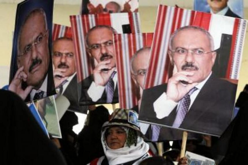 Supporters of Yemeni ex-president Ali Abdullah Saleh hold his posters during a rally marking the 35th anniversary celebrations for the formation of Saleh's party of General People's Congress, in Sana'a, Yemen on Aug 24, 2017.