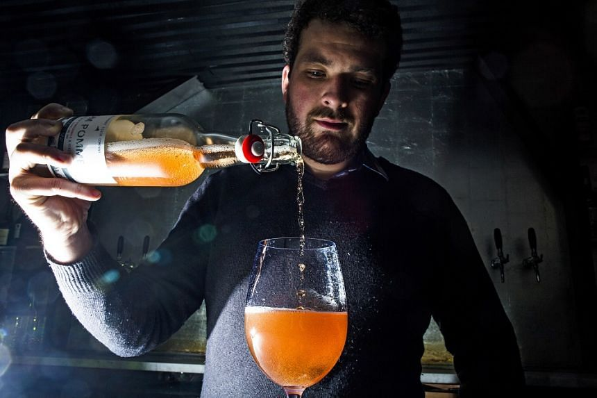 Beverage consultant Dan Pucci pours a cider at the restaurant Wassail, where he was once the pommelier, or cider director, in New York, in March 2017.