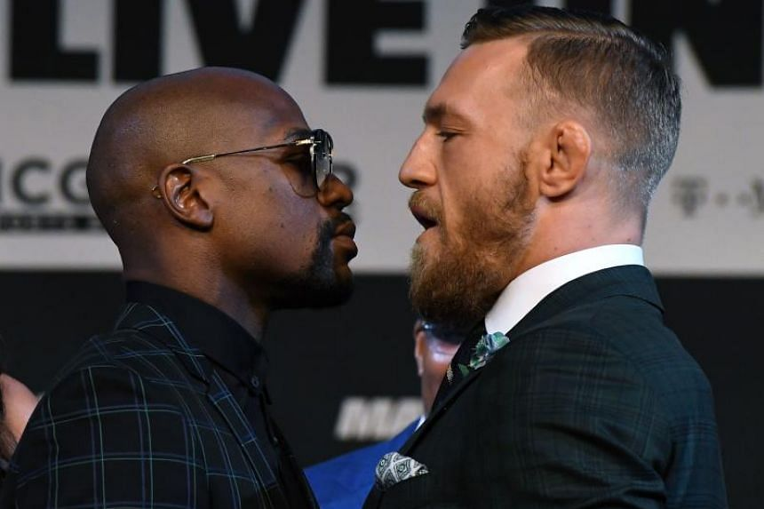 Floyd Mayweather Jr. (left) and Conor McGregor face off during a news conference at the KA Theatre at MGM Grand Hotel & Casino in Las Vegas.