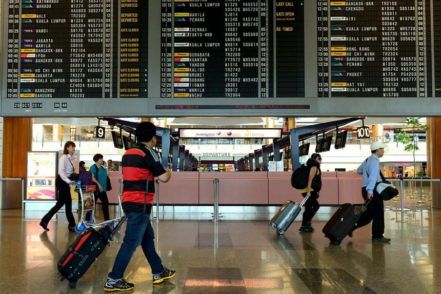 Travellers at the Departure Hall of Changi Airport Terminal 2.