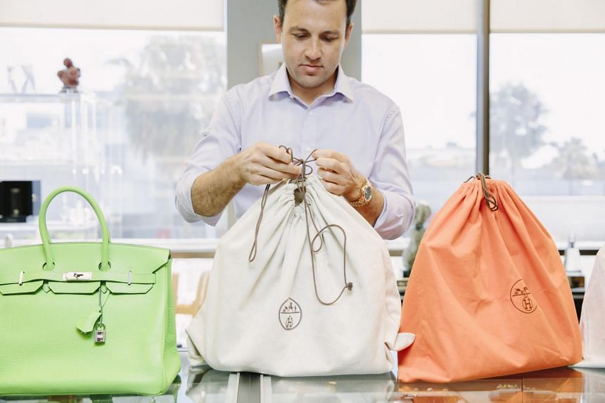 Mr Jordan Tabach-Bank, an owner of the Beverly Loan Co, with Birkin handbags at the shop in Beverly Hills, on June 19, 2017.
