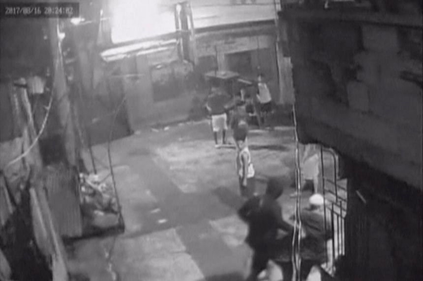 CCTV footage appearing to show Kian Loyd Delos Santos being dragged by plain-clothed police past a basketball court in Caloocan City Barangay, Philippines.