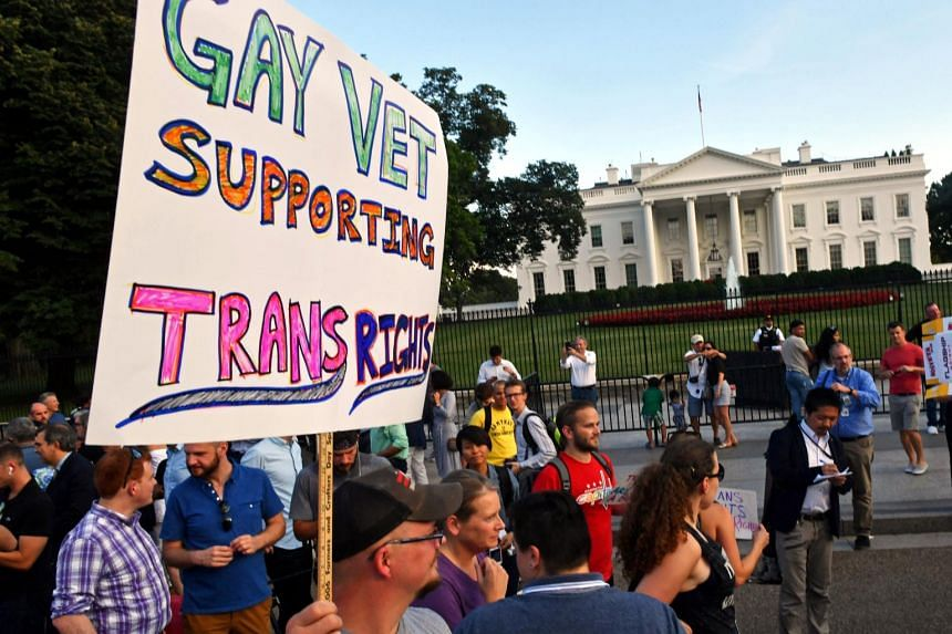 Protesters gather in front of the White House on July 26, 2017, in Washington, DC.