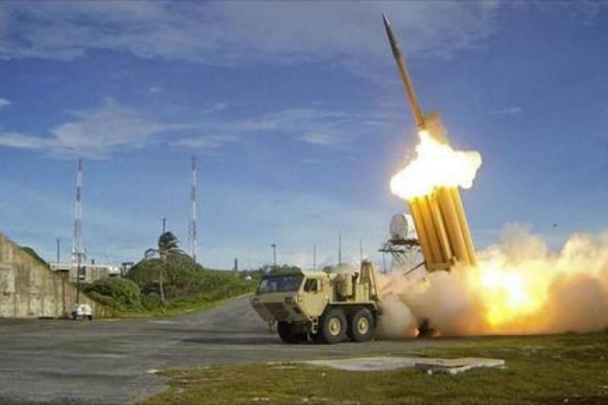 The first of two Terminal High Altitude Area Defence (Thaad) interceptors is launched during a successful intercept test at an undisclosed location in the US on Sept 10, 2013.