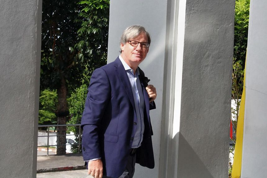 BBC foreign correspondent Jonathan Head arrives at court to fight defamation charges brought against him by a Thai lawyer in Phuket on Aug 23, 2017.
