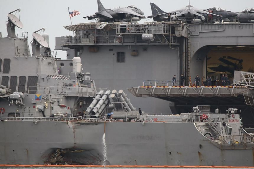 The damaged port side hull of the United States Navy missile destroyer USS John S. McCain.