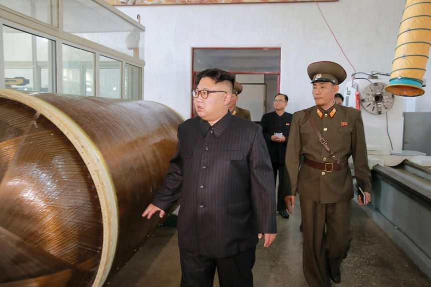 North Korean leader Kim Jong-Un looks on during a visit to the Chemical Material Institute of the Academy of Defense Science in this undated photo released by North Korea's Korean Central News Agency in Pyongyang on Aug 23, 2017.