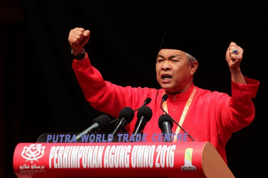 Deputy Prime Minister Datuk Seri Dr Ahmad Zahid Hamidi delivering his speech at the Umno general assembly.