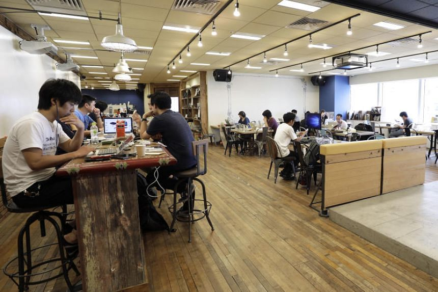 Members working in the shared office at DMM.make Akiba, a hardware incubation space operated by DMM.com in Tokyo, Japan, on July 18, 2017.