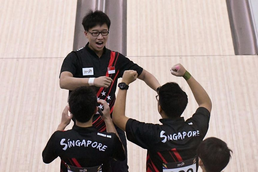 Singapore's men's bowling team celebrating during their team-of-five match at the SEA Games on Aug 24, 2017.