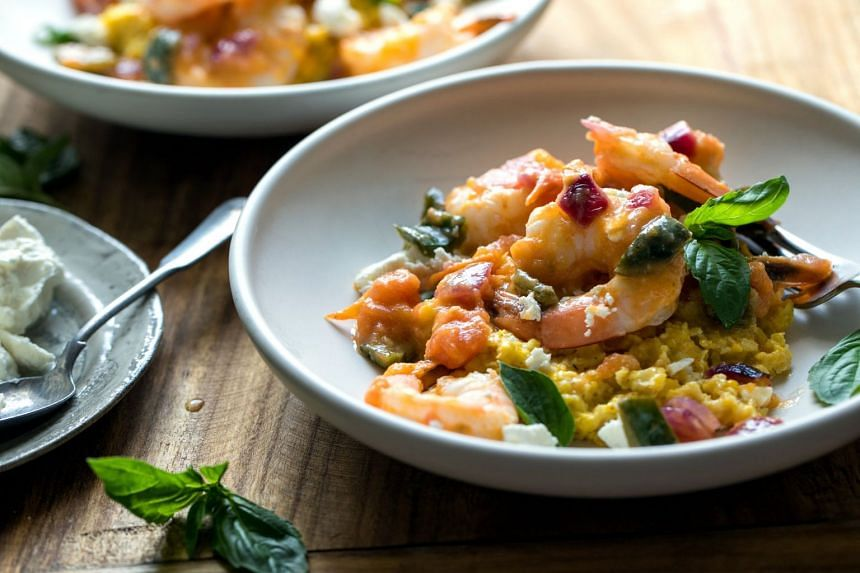 Sauteed shrimp with creamed corn and feta is an inauthentic but fresh take on shrimp and grits.