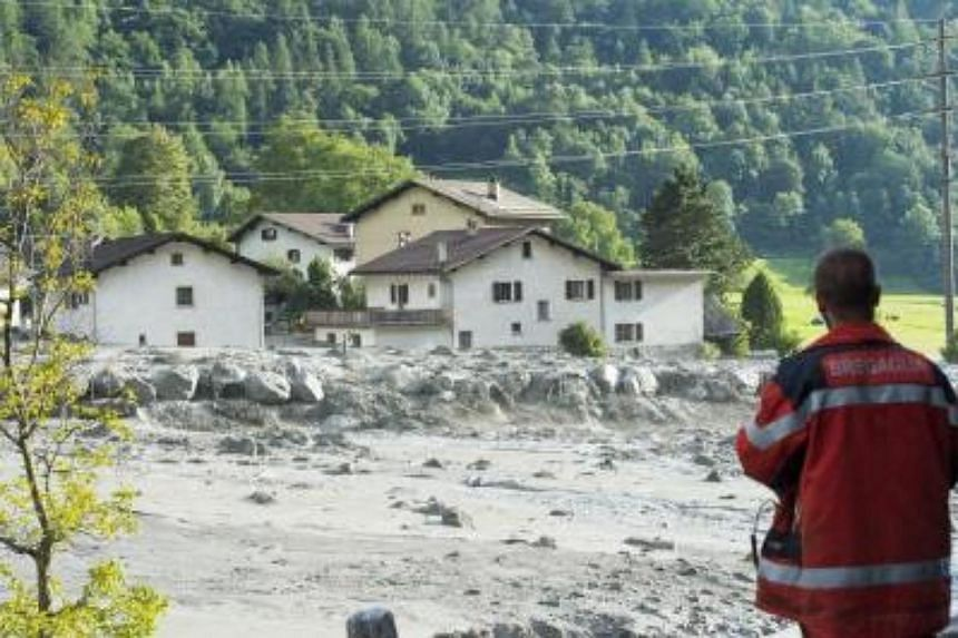 An emergency worker watching the site of the massive landslide that hit Bondo village in south Switzerland on Aug 23, 2017.