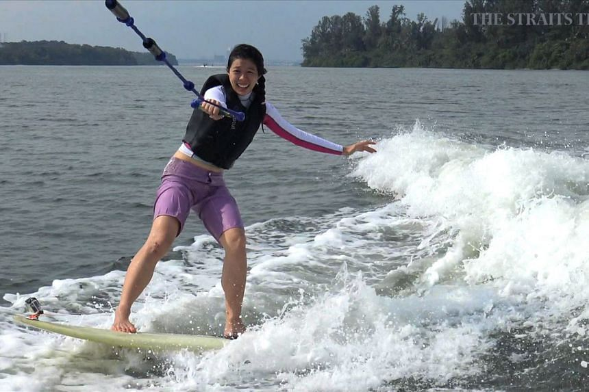 In an episode of Bridget's Adventures, Straits Times journalist Bridget Tan hangs on for dear life as she attempts wakesurfing for the first time. ST FILE PHOTO: SPH