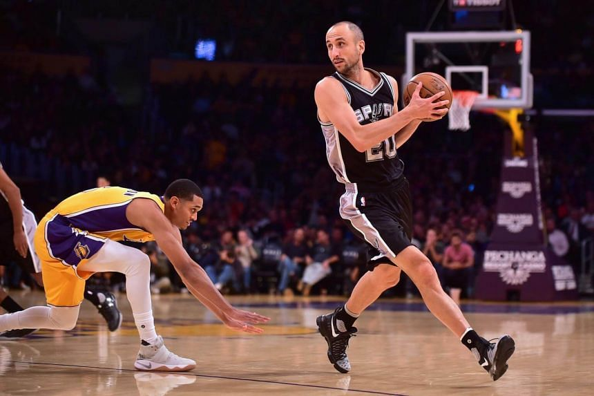 Manu Ginobili (right) as he looks to pass getting away from Jordan Clarkson of the Los Angeles Lakers during the NBA basketball matchup in Los Angeles, on Nov 18, 2016.