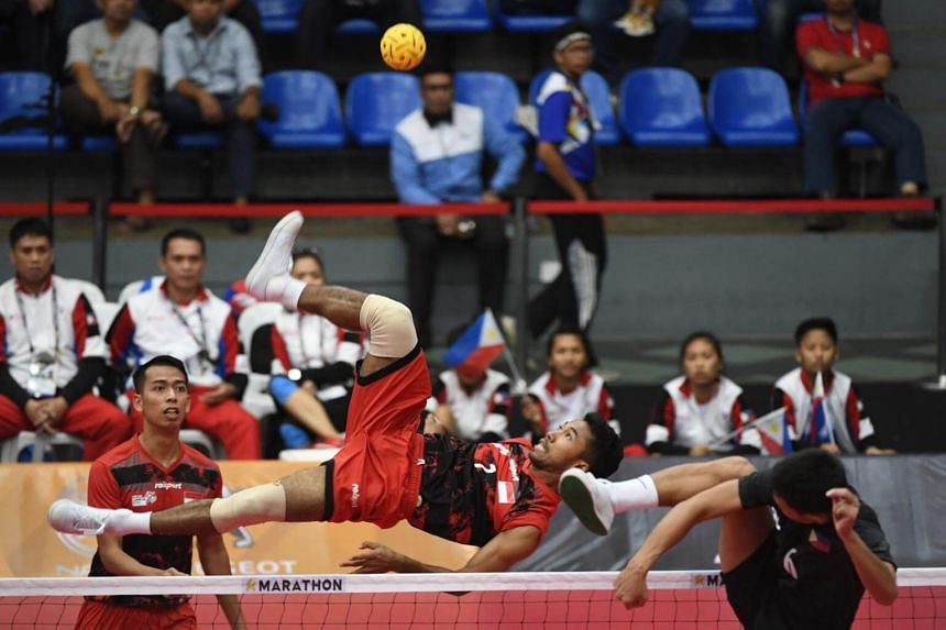 Indonesia's Syaiful Rijal (left) competes with Regie Reznan Fabriga of the Philippines during their men's team doubles preliminary round robin sepak takraw match at the 29th Southeast Asian Games (SEA Games) in Kuala Lumpur on Aug 21, 2017.