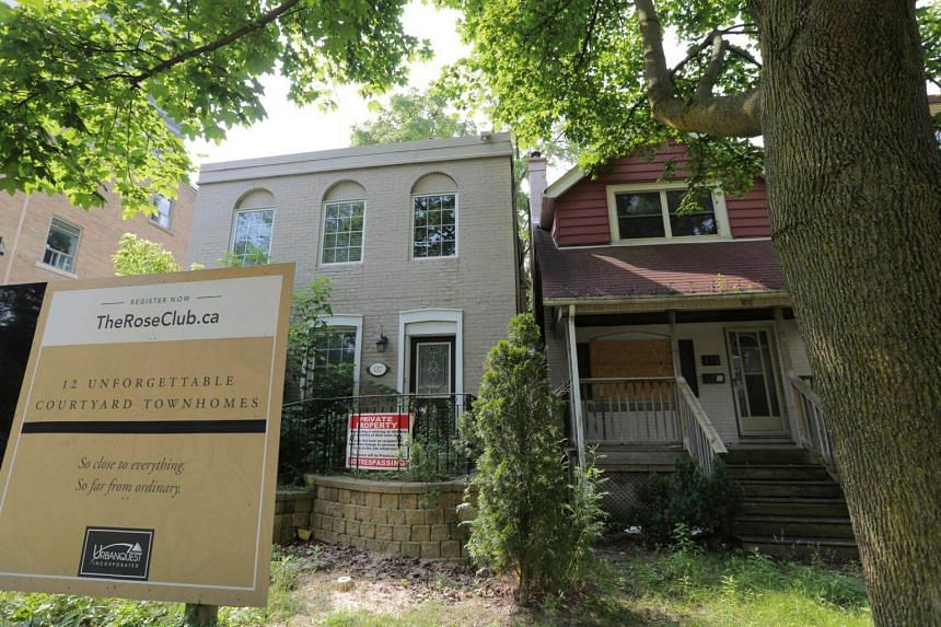 Houses slated for demolition due to a condominium development lie empty as Canada's central bank announced its first interest rate hike in nearly seven years, on a residential street in midtown Toronto, on July 12, 2017.