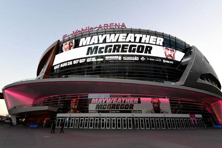Advertisements for the bout between boxer Floyd Mayweather Jr. and UFC lightweight champion Conor McGregor are displayed on the side of T-Mobile Arena in Las Vegas, on Aug 24, 2017.