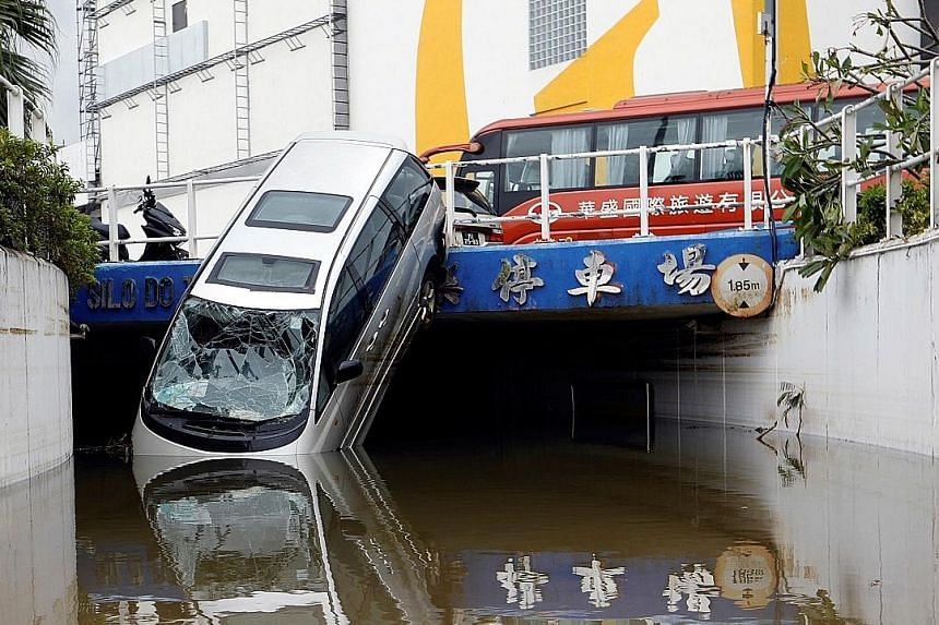 A car pushed into a canal after floods swept through the streets of Macau.