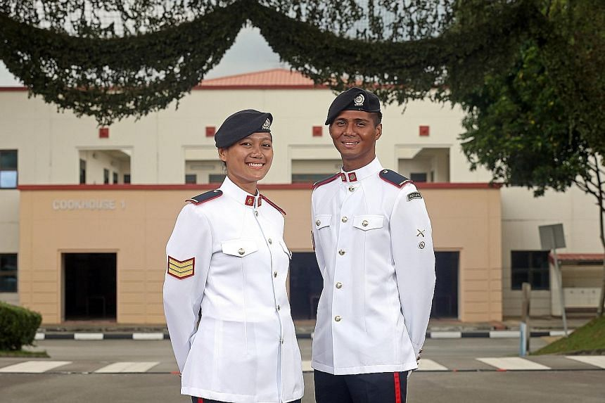 3SG Farah Halim, 25, with her husband 3SG Raj Kishen Ravichandran, also 25. Both were among the1,134 specialist cadets at the 32nd Specialist Cadet Graduation Parade held at Pasir Laba Camp yesterday. Ms Halim received the Silver Bayonet while her hu