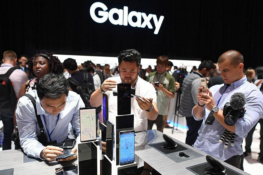 Members of the media at a preview of the Samsung Galaxy Note8 on Wednesday. The phone has dual rear cameras, added features for its S Pen Stylus and a large 6.3-inch display.