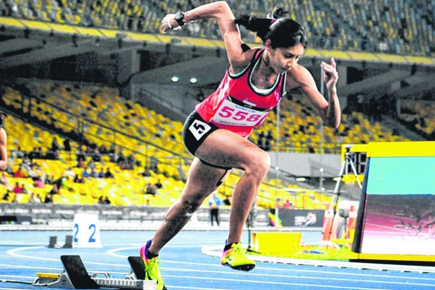 Dipna Lim-Prasad exploding out of the blocks on her way to the silver medal in the 400m yesterday. Her time of 54.18sec bettered Chee Swee Lee's national mark of 55.08sec, set at the 1974 Asian Games in Iran.