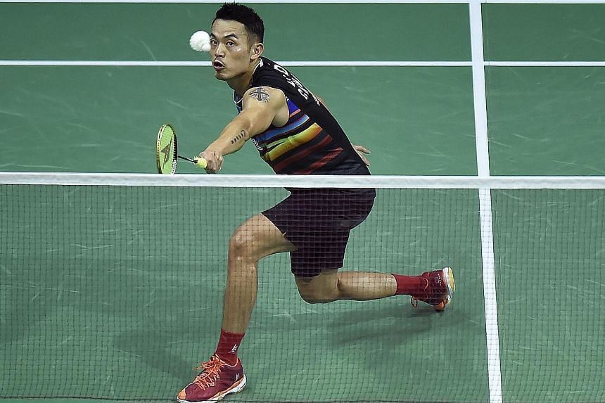 China's Lin Dan returning against England's Rajiv Ouseph during their third-round match at the World Championships in Glasgow yesterday. The five-time world champion won the match 14-21, 21-17, 21-16.