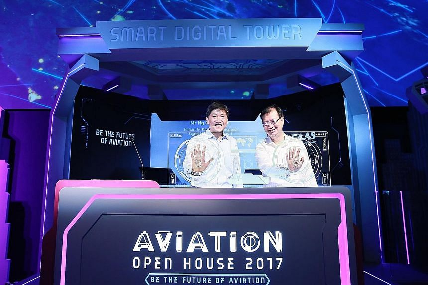 Minister for Education (Schools) and Second Minister for Transport Ng Chee Meng (left) and Mr Kevin Shum, director-general of the Civil Aviation Authority of Singapore, launching the Aviation Open House, which showcases career and education opportuni