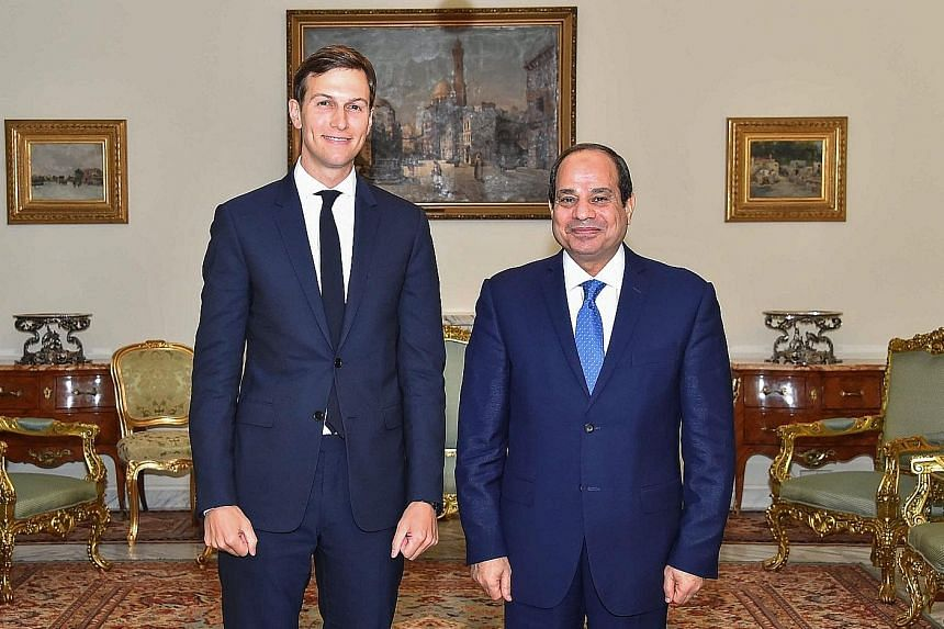 Mr Jared Kushner, senior adviser to the US President, with President Abdel Fattah el-Sissi of Egypt. Both men gave no public hint of bilateral discord as they grinned and shook hands for the media.