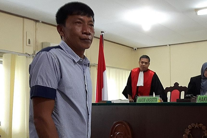 Singaporean Shoo Chiau Huat, who was nabbed for illegal fishing off Bintan island, at a court hearing in Tanjung Pinang last year. Indonesia's Supreme Court has turned down an appeal against his acquittal, but the boat captain still remains in detent