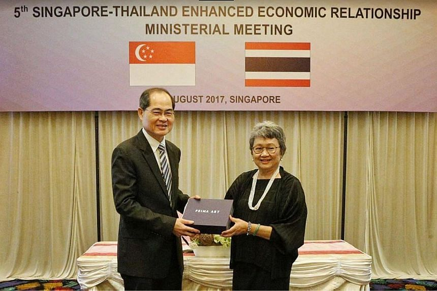 Above: Singapore's Minister for Trade and Industry (Trade), Mr Lim Hng Kiang, with Thailand's Minister of Commerce, Mrs Apiradi Tantraporn, at the 5th Singapore-Thailand Enhanced Economic Relationship (Steer) Ministerial Meeting held in Singapore yes