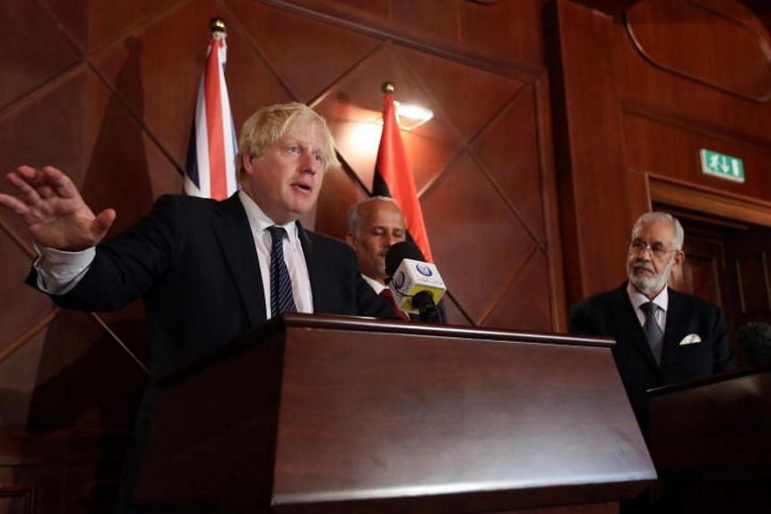 British Foreign Minister Boris Johnson (left) at a press conference with Mohamed al-Taher Siala (right), Foreign Minister of the UN-backed Libyan Government of National Accord, in the capital Tripoli on Aug 23, 2017.