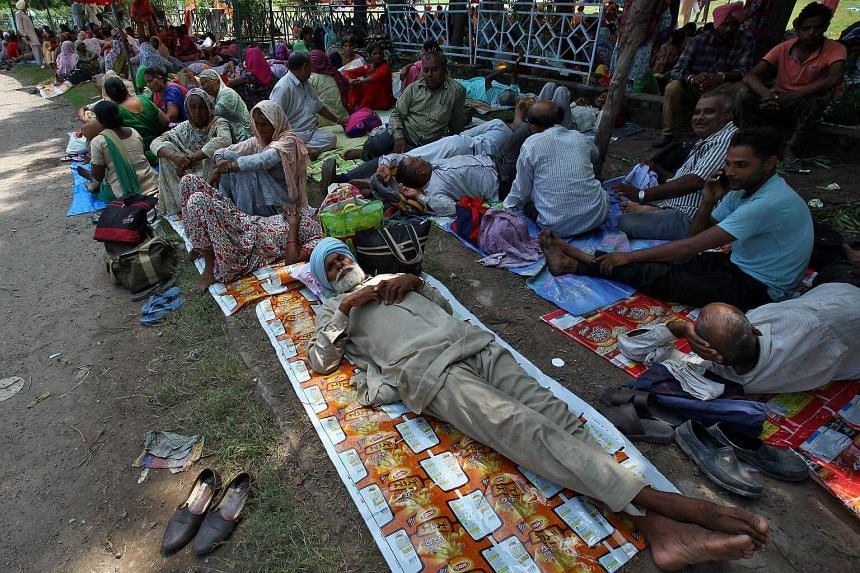 """Supporters of Gurmeet Ram Rahim Singh awaiting the verdict on charges against him. The spiritual head of the Dera Sacha Sauda sect is accused of molesting two female worshippers, a charge which he and his supporters deny. The self-styled """"godman"""" has"""